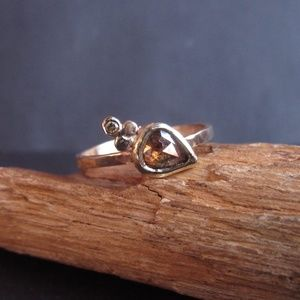 14k yellow solid gold ring with brown diamond.